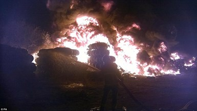 tyre fire with firefighter